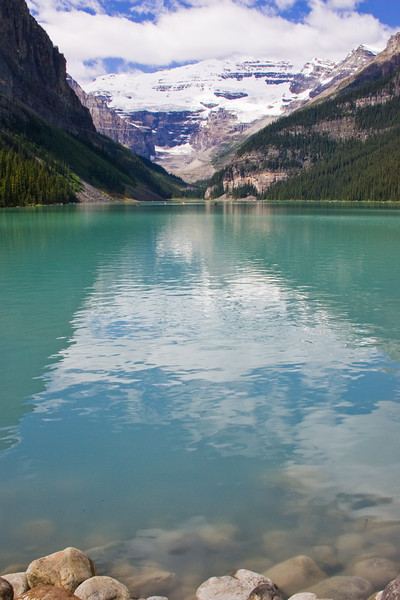 Lake Louise and Victoria Glacier in Banff National Park in Alberta, Canada. The main attraction to Lake Louise for many is the sparkling turquoise lake itself. The beautiful, milky blue or turquoise (depending on the light) lake rests at the foot of Victoria Glacier, which rises majestically behind, capped by snow and ice year-round. First sighted by Europeans in 1882, the lake has become one of Canada's best-loved sights and the most photographed scene in the Canadian Rockies.