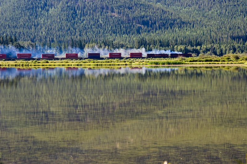 Canadian Pacific Railroad Train  passing by the Vermillion Lakes near the town of Banff, in Banff National Park, Alberta, Canada.
