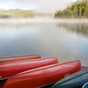 Canoes in fog on Patricia Lake in Jasper National Park, Alberta, Canada.