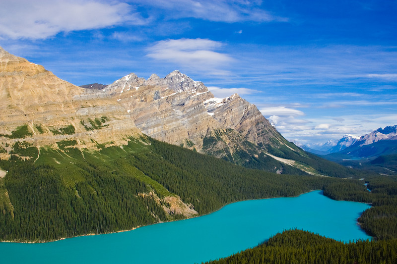 Peyto Lake is a glacier-fed lake located in Banff National Park in the Canadian Rockies.  The Lake is accessed from the Icefields Parkway. It was named for Ebenezer William Peyto, an early trail guide and trapper in the Banff area. The lake is formed in a valley of the Waputik Range, between Caldron Peak, Peyto Peak and Mount Jimmy Simpson, at an elevation of 1,860 m (6,100 ft).