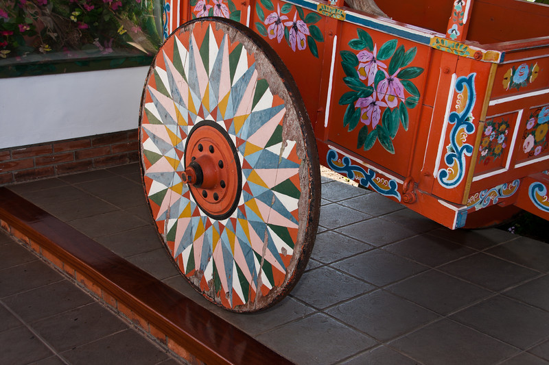 Decorated cart and wagon wheels are on display as examples of native costa rican culture and craft at the Bougainvillea Hotel in San Jose, Costa Rica.