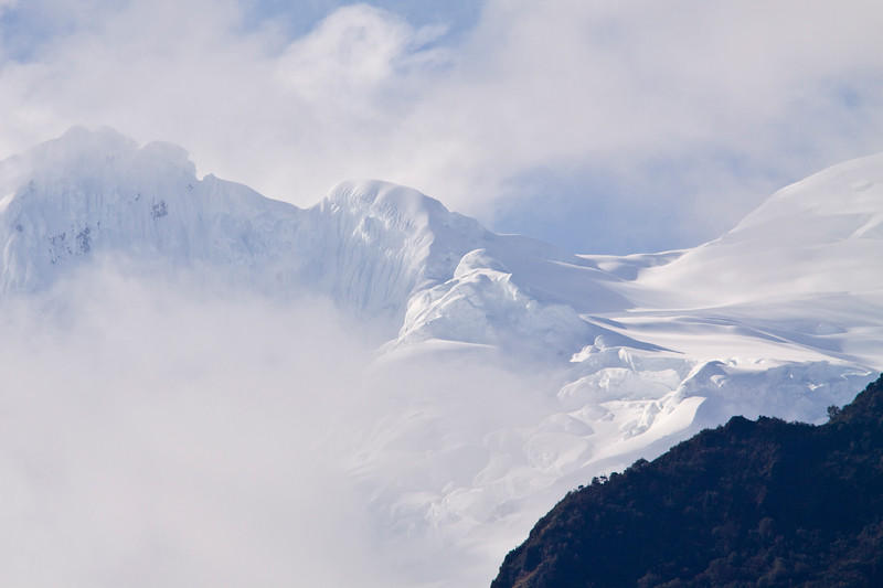 Antisana Volcano, covered in ice and snow, viewed from the Termas de Papallacta Resort in Ecuador.