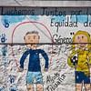 Roadside signs and murals near Quito, Ecuador.