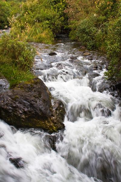 Waterfall on river at Termas de Papallacta Resort in Ecuador.
