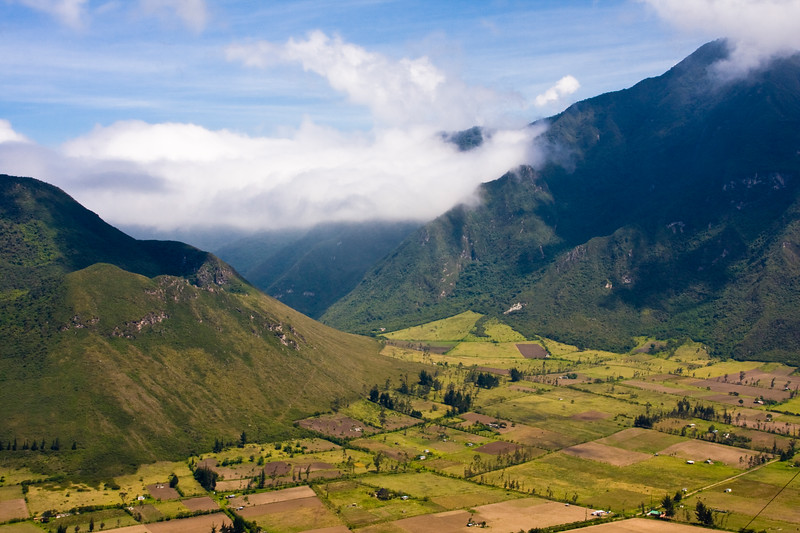 """Pululahua Geobotanical Reserve in Ecuador. Pululahua is a Quichua word that means """"cloud of water"""" or fog. It is a collapsed volcano with great biodiversity and unique geological formations. It is due to this uniqueness that it was declared a Geobotanical Reserve. The people living in the caldera, the only in the world with agricultural production, grow maize (Zea mays), bean (Phaseolus coccineus), bean (Vicia fava), potato (Solanum tuberosum), vegetables, tree tomato, alfalfa, among other."""