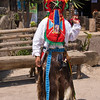 Ecuadorian native in El Diablo costume at equator museum near Quito.
