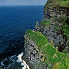 Cliffs of Moor, A major tourist attraction in Ireland. An Irish Castle is visible on the far cliff.