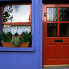 Brightly painted door and window in Westport, Ireland, a town in County Mayo.