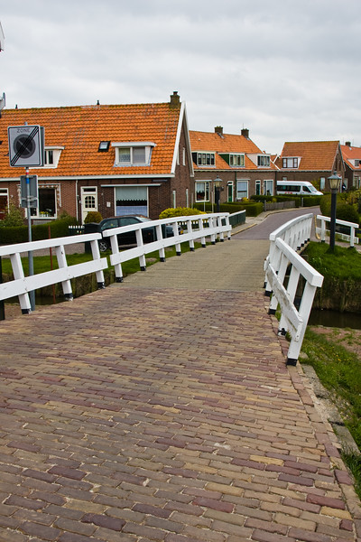 Marken in North Holland, The Netherlands, is a fishing village forced to turn at least somewhat to tourism when the dike closed off the North Sea and formed the Isselmeer Lake. Villagers wear old dutch clothing/costumes.