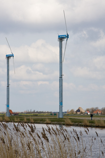 Modern windmills along the N9 highway in North Holland, The Netherlands.