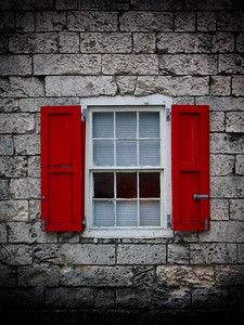 Red Shutters on a Stone Wall