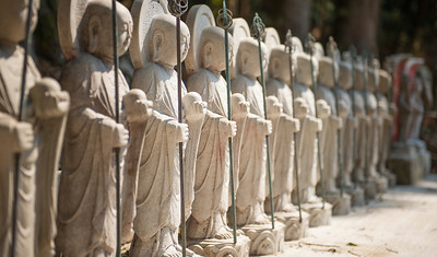 Row of white standing Buddhist statues, Daigoji, Kyoto, Japan - 2014