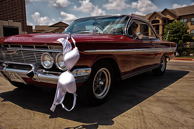 """July 20, 2012  Jennifer """"hanging out"""" on a 1962 Chevy Impala and our friend Allen who owns this awesome 1962 Chevy Impala is behind the wheel with a big smile.  It's been fun having Jennifer and I will be posting a couple more photos on the Dailies, but then will upload to Jennifer's Road trip gallery to whole serious.  I sure enjoyed and got lots of laughs from all your comments about the shot of Jennifer yesterday.  Thanks very much.  TGIF!!!  Linda"""