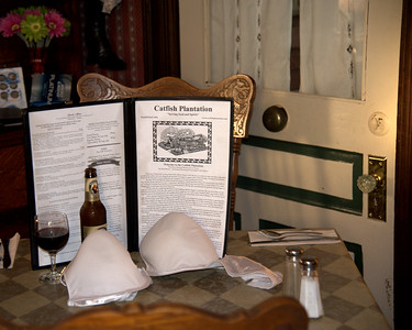 """We took Jennifer to dinner with us at a local restaurant named the Catfish Plantation, which is rumoured to be haunted.  According to a posting on the Intranet by Rick Moran:  The term """"Haunted,"""" as any respectable Ghost Hunter will tell you, is a relative term and often misunderstood by the public; but one thing all paranormal investigators agree with is that the 1895 Victorian at 814 Water Street in Waxahachie is most definitely the residence of several earthbound spirits.  In 1984, Tom and Melissa Baker found the property, which had been empty for several years and while it was not the perfect location to start a restaurant, they both agreed that the house had a certain charm that could not be denied. Neither were big fans of the paranormal but shortly after purchasing the property, things began to happen that would make them true believers.  While only the couple had the keys to the building, Melissa began to find that she was obviously not the only one with access. One day, she came in to find a large tea urn, with neatly stacked coffee cups inside, which had somehow been transported to the middle of the floor, far away from where they belonged.  On another morning, she came in to find fresh brewed coffee waiting for her! Once opened, employees began to tell strange stories; a fry basket levitating in the kitchen, a glowing blue light illuminating a room that was otherwise empty and the ghostly figure of a bride standing by a front window.  The sheer number of reports was overwhelming and paranormal investigators were invited to give their impressions of the old house.  What they found was a list of characters from Waxahachie's past, each with distinct personalities, each existing independent of one other at the restaurant. Among the resident spirits is a man who likes to """"flirt"""" with female guest by touching their knee or shoulder or playing with their long hair; a young female who seems confused by her surroundings and """"Caroline,"""" a previous owner who sometim"""