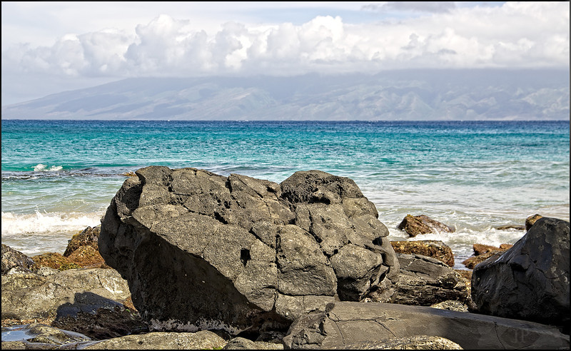 Black Rocks Blue Water