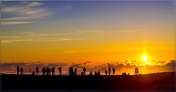 """Sunset on top of the Volcanic mountain """"Haleakalā""""  over 10,000 feet about sea level.  In the Hawaiian language Haleakalā means """"House of the Sun"""". In Hawaiian folklore, the depression (crater) at the summit of Haleakalā was home to the grandmother of the demigod Māui. According to the legend, Māui's grandmother helped him capture the sun and force it to slow its journey across the sky in order to lengthen the day."""