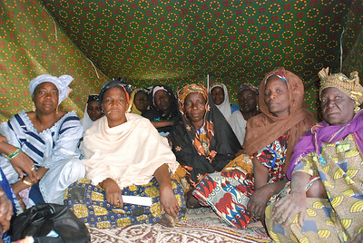 An association of women greets me in their tent.  They organized to help each other, after devastating flash floods leveled their houses. Niger, 2010