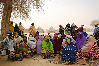 Gangale women's association, in wind and sand-blown desert