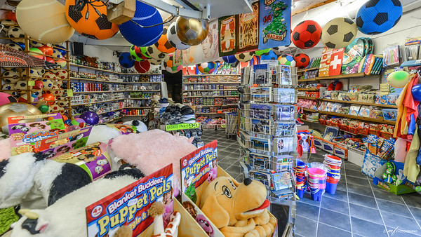 A toy store near the car park. Just like the town, it was full of colors, and when I was looking through the wide angle, looked very unusual and nice. Why not take a shot, right?