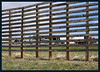 Big snow fences along Interstate 80, about 10 feet tall (with Phay in the background).