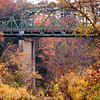 Bridge on Arkansas Scenic Highway 7 over the Buffalo River in autumn. Viewed from one of many park areas found in the Buffalo National River districts and managed by the National Park Service. The Buffalo River is the first river to receive the National River designation. This park and campground area is located just off of Arkansas scenic byway 7.