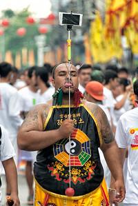 Mystic with Cellphone through Tongue, Phuket Vegetarian Festival, Thailand - 2015