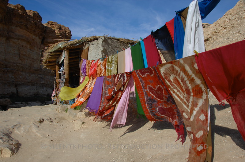 Rugs for sale, and catching a breeze in the open air.