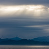 Sun Rays through rain clouds in Alaska Inside Passage.