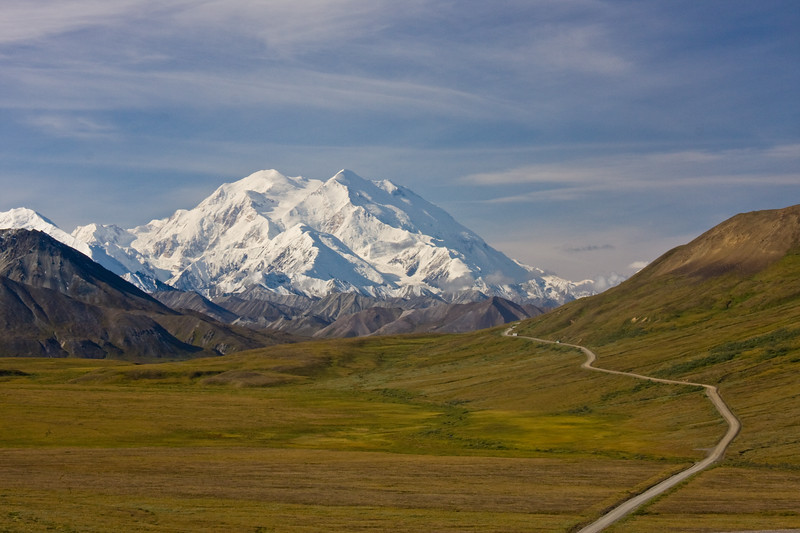 """Mt. McKinley - known by Alaskans and native americans as Denali (meaning The High One) is the tallest mountain in North America at 20,320 feet. It is rare to see the top of Denali without clouds as tall mountains often """"make their own weather."""""""