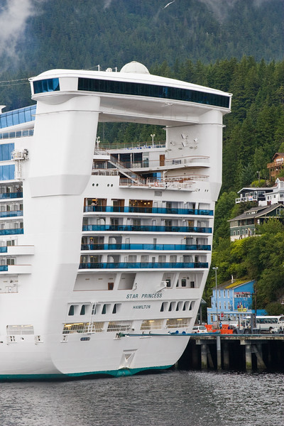 Cruise Ship at Ketchican, Alaska, port of call for Alaska cruise ships following the Inside Passage route. These ships are massive and tower over the small town set against the mountains.