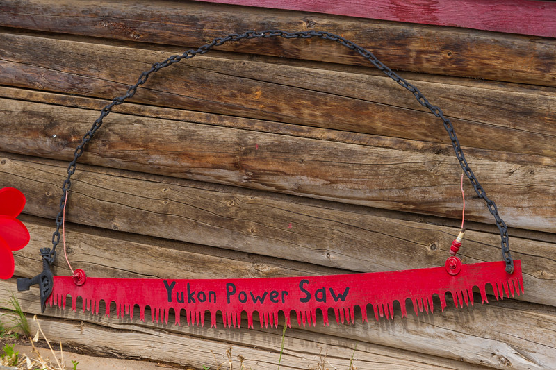 """Rugged humor in the Yukon Territory at Moose Creek Lodge, with a hand saw identified as a """"power saw""""."""
