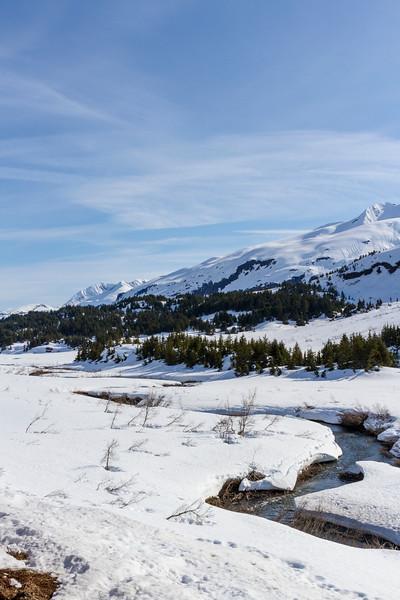 Snow and ice in Kenai Mountains of Alaska, viewed from Alaska Railroad train going from Anchorage to Seward, Alaska.
