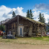 """Log cabin homestead accessible only on """"Top of the World Highway"""" which is closed in winter and is only passable in the summer months."""