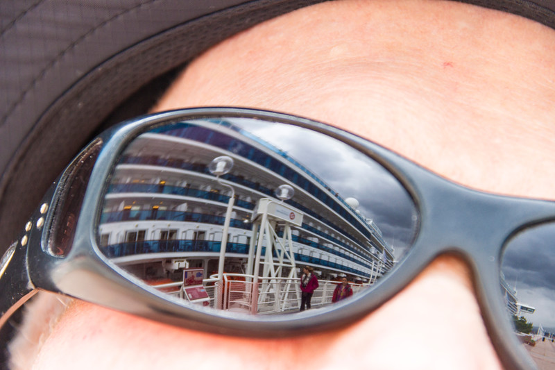 Reflection of Golden Princess Cruise Ship in sunglasses of tourist in downtown Vancouver.