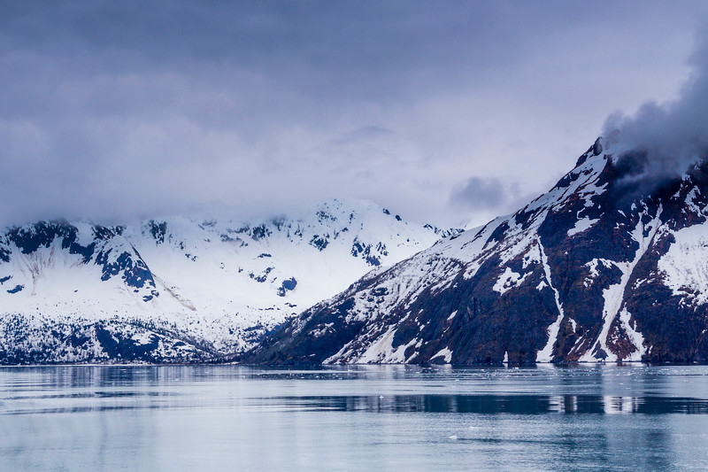 Rain, snow, and sleet on the mountains and glaciers in Northwestern Fjord of the Kenai Fjords National Park in Alaska.