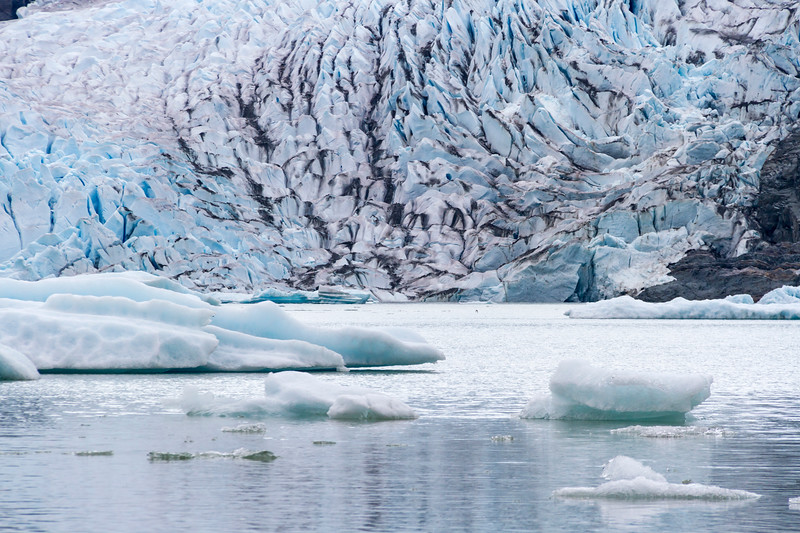 Mendenhall Glacier is about a 12 mile long glacier in Mendenhall Valley, about 12 miles  from downtown Juneau. It is a major tourist attraction for Juneau cruise ship passengers.