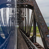 Alaska Railroad train crossing railroad bridge over Nenana River at Nenana, Alaska.