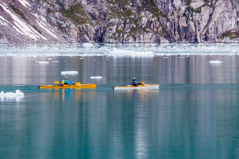 Kayakers and icebergs near Norwestern Glacier in Northwestern Fjord of the Kenai Fjords National Park in Alaska.