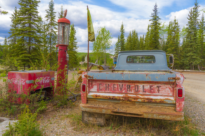 Historic, antique pickup truck, gas pump, and Coca Cola cooler, on the grounds of Moose Creek Lodge on the North Klondike highway in Yukon Territory, Canada.