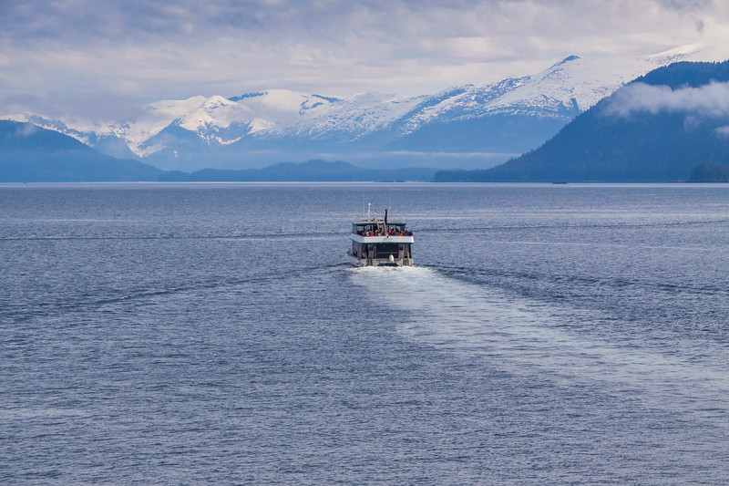 Tour boat picking up passengers from Volendam Cruise Ship for tour of Tracy Arm passage and glaciers in the inside passage to Alaska.