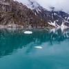Cold, blue-green waters of Northwestern Fjord, near the Northwestern Glacier, in Kenai Fjords National Park in Alaska.