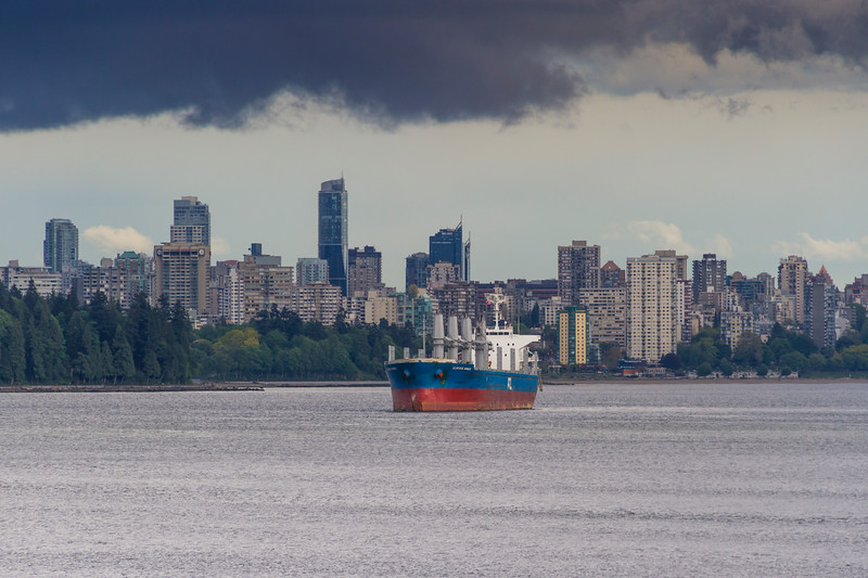 Vancouver harbor and skyline on a stormy day in May.