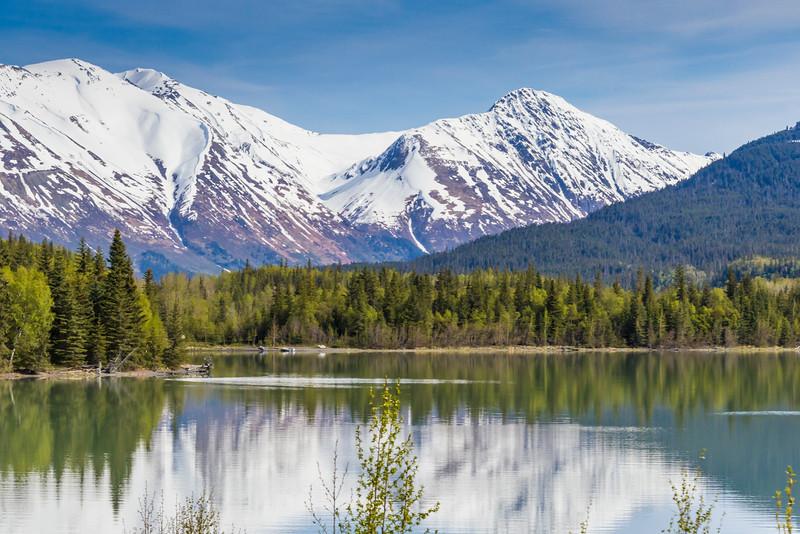 Reflections of Snow Covered Mountains in Kenai Lake on the Kenai Peninsula, near Seward, Alaska.