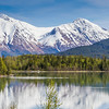 Reflections of Snow Covered Mountains in Kenai Lake on the Kenai Peninsula, near Seward, Alaska.