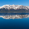 Reflections of Snow covered mountains in beautiful blue waters of Turnagain Arm, an arm of Cook Inlet (which almost surrounds Anchorage).