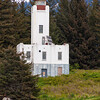 Sentinel Island Lighthouse, established in 1935 (station established 1902). The Keeper's house was burned in 1971. This is One of Alaska's two oldest light stations. In 1998 a preservation group leased the lighthouse and opened it for custom day tours or overnight visitors. Located about 25 miles from Juneau, Alaska.