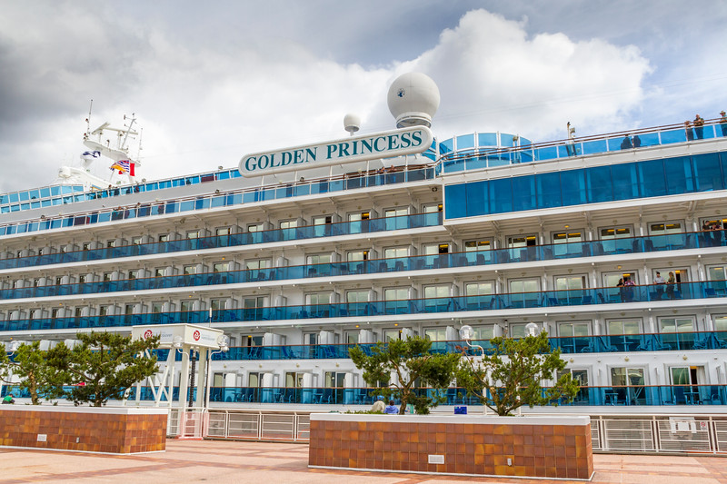"""Princess Cruise LIne ship """"Golden Princess"""" at Canada Place cruise ship terminal at Vancouver Harbor in downtown Vancouver, British Columbia, Canada."""