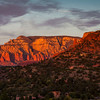 Sunset light is very dramatic on red sandstone rock hills around Sedona, Arizona.