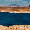 Navajo Mountain, a mountain sacred to the Navajo people, can be seen in the distance from Lake Powell near the Wahweap Marina in Arizona. Navajo Mountain peak is in Utah, but its lower flanks extend into Arizona.