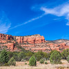 Red Sandstone hills around Sedona, Arizona, are a unique geological formation known as the Schnebly Hill Formation. The Schnebly Hill Formation is a thick layer of red to orange-colored sandstone found only in the Sedona vicinity.
